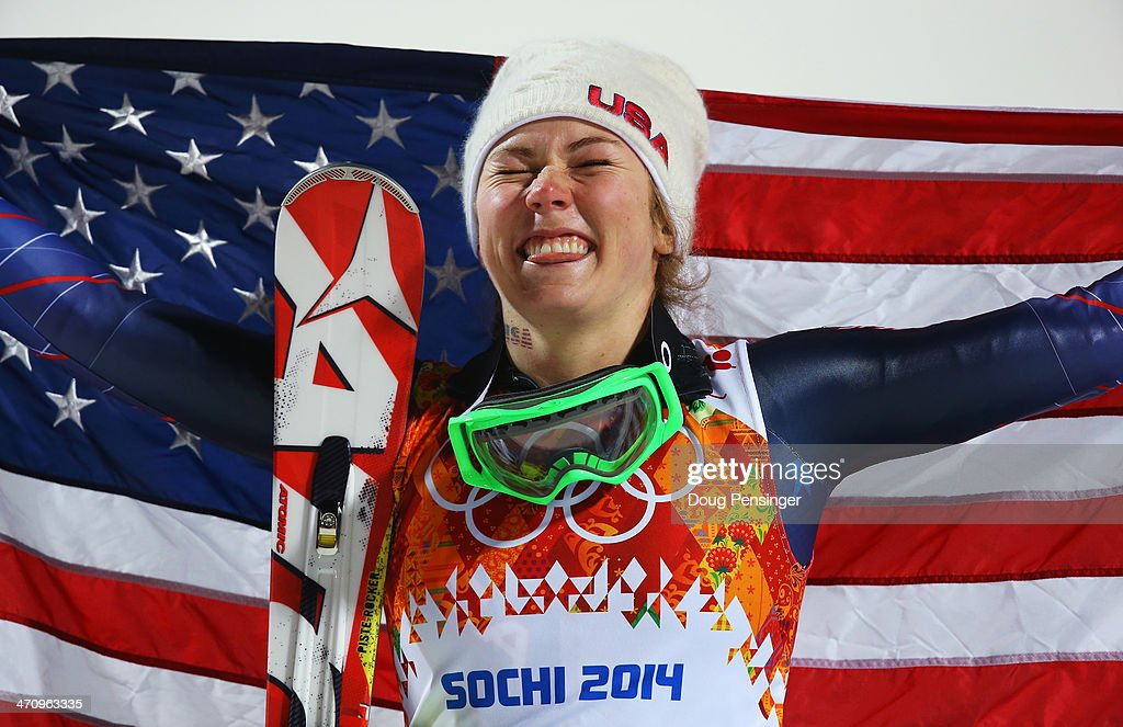 Gold medalist <a gi-track='captionPersonalityLinkClicked' href=/galleries/search?phrase=Mikaela+Shiffrin&family=editorial&specificpeople=7472698 ng-click='$event.stopPropagation()'>Mikaela Shiffrin</a> of the United States celebrates during the flower ceremony for the Women's Slalom during day 14 of the Sochi 2014 Winter Olympics at Rosa Khutor Alpine Center on February 21, 2014 in Sochi, Russia.