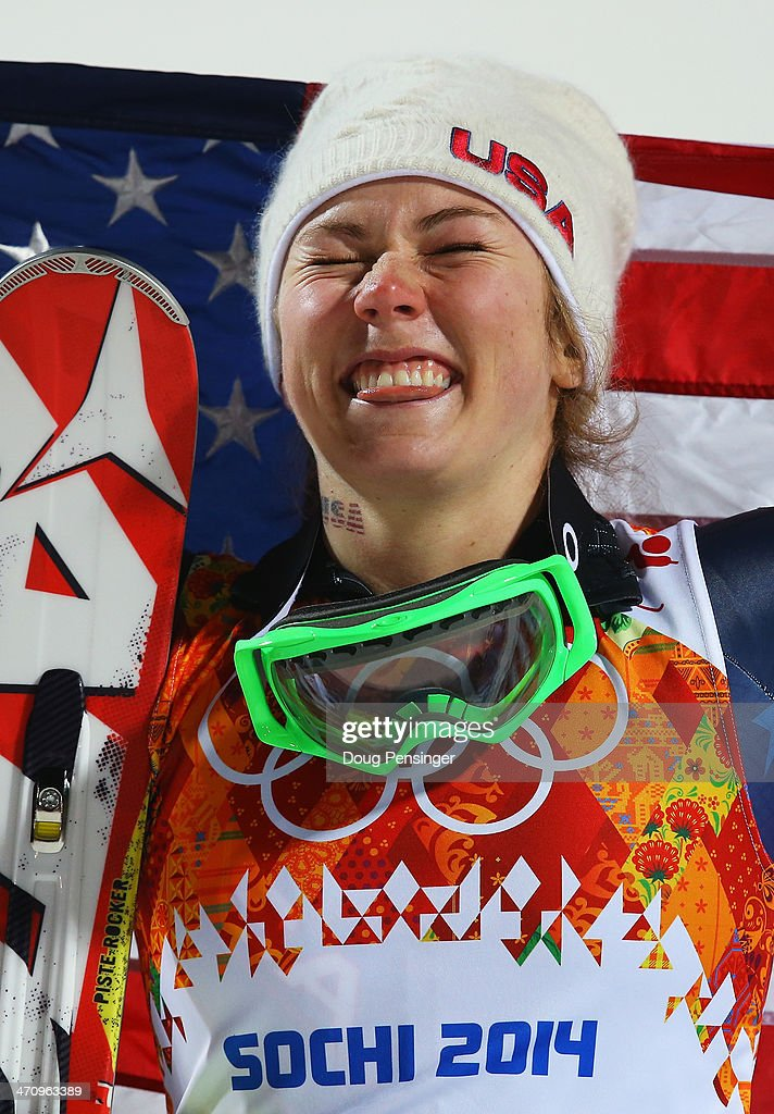 Gold medalist Mikaela Shiffrin of the United States celebrates during the flower ceremony for the Women's Slalom during day 14 of the Sochi 2014 Winter Olympics at Rosa Khutor Alpine Center on February 21, 2014 in Sochi, Russia.