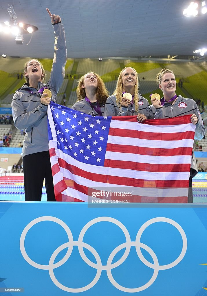 US gold medalist Missy Franklin Allison Schmitt Dana Vollmer and US Shannon Vreeland pose on the podium after winning the women's 4x200m freestyle...