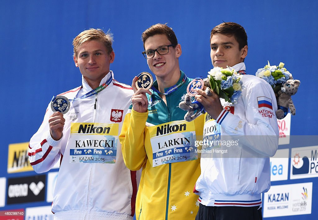 Gold medalist <a gi-track='captionPersonalityLinkClicked' href=/galleries/search?phrase=Mitch+Larkin&family=editorial&specificpeople=7619818 ng-click='$event.stopPropagation()'>Mitch Larkin</a> (C) of Australia poses with silver medalist Radoslaw Kawecki (L) of Poland and bronze medalist Evgeny Rylov (R) of Russia during the medal ceremony for the Men's 200m Backstroke on day fourteen of the 16th FINA World Championships at the Kazan Arena on August 7, 2015 in Kazan, Russia.