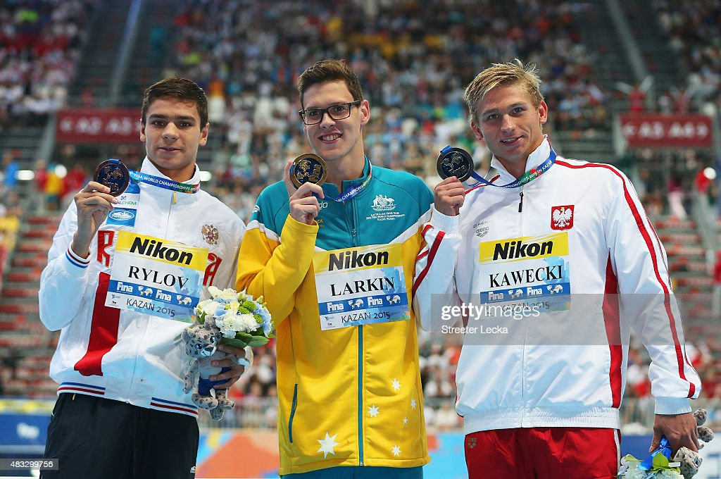 Gold medalist <a gi-track='captionPersonalityLinkClicked' href=/galleries/search?phrase=Mitch+Larkin&family=editorial&specificpeople=7619818 ng-click='$event.stopPropagation()'>Mitch Larkin</a> (C) of Australia poses with silver medalist Radoslaw Kawecki (R) of Poland and bronze medalist Evgeny Rylov (L) of Russia during the medal ceremony for the Men's 200m Backstroke on day fourteen of the 16th FINA World Championships at the Kazan Arena on August 7, 2015 in Kazan, Russia.