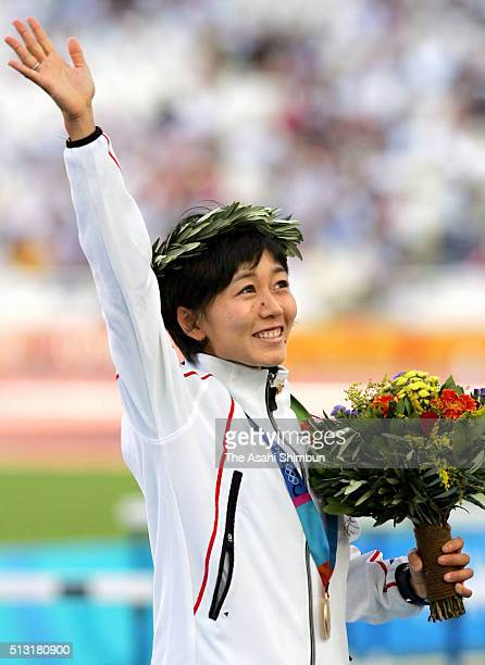 Gold medalist Mizuki Noguchi of Japan celebrates on the podium at the medal ceremony for the Women's Marathon at the Olympic Stadium during day ten...