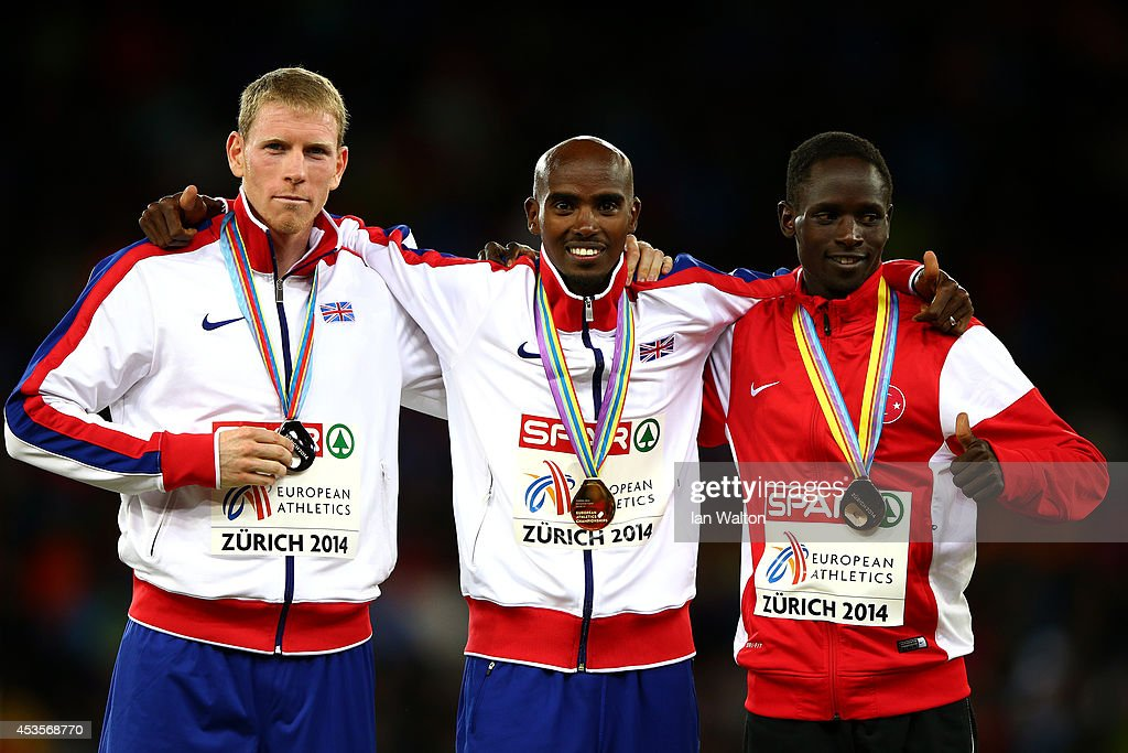 Gold medalist <a gi-track='captionPersonalityLinkClicked' href=/galleries/search?phrase=Mo+Farah&family=editorial&specificpeople=4819130 ng-click='$event.stopPropagation()'>Mo Farah</a> of Great Britain and Northern Ireland poses next to silver medalist <a gi-track='captionPersonalityLinkClicked' href=/galleries/search?phrase=Andy+Vernon&family=editorial&specificpeople=5436593 ng-click='$event.stopPropagation()'>Andy Vernon</a> of Great Britain and Northern Ireland and bronze medalist Ali Kaya of Turkey during the medal ceremony for the Men's 10,000 metres final during day two of the 22nd European Athletics Championships at Stadium Letzigrund on August 13, 2014 in Zurich, Switzerland.