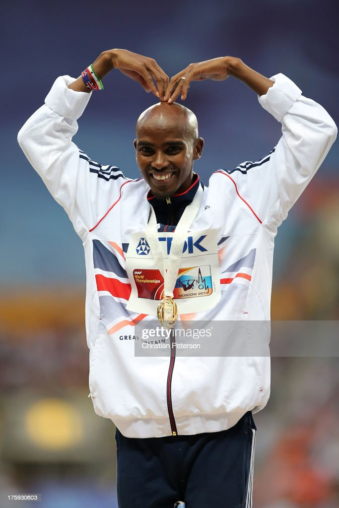Gold medalist <a gi-track='captionPersonalityLinkClicked' href=/galleries/search?phrase=Mo+Farah&family=editorial&specificpeople=4819130 ng-click='$event.stopPropagation()'>Mo Farah</a> of Great Britain on the podium during the medal ceremony for the Men's 10000 metresduring Day One of the 14th IAAF World Athletics Championships Moscow 2013 at Luzhniki Stadium on August 10, 2013 in Moscow, Russia.