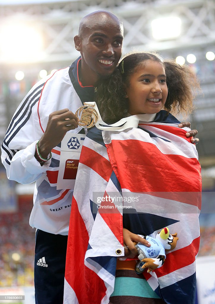 Gold medalist <a gi-track='captionPersonalityLinkClicked' href=/galleries/search?phrase=Mo+Farah&family=editorial&specificpeople=4819130 ng-click='$event.stopPropagation()'>Mo Farah</a> of Great Britain on the podium with daughter Rhianna Farah during the medal ceremony for the Men's 10000 metresduring Day One of the 14th IAAF World Athletics Championships Moscow 2013 at Luzhniki Stadium on August 10, 2013 in Moscow, Russia.