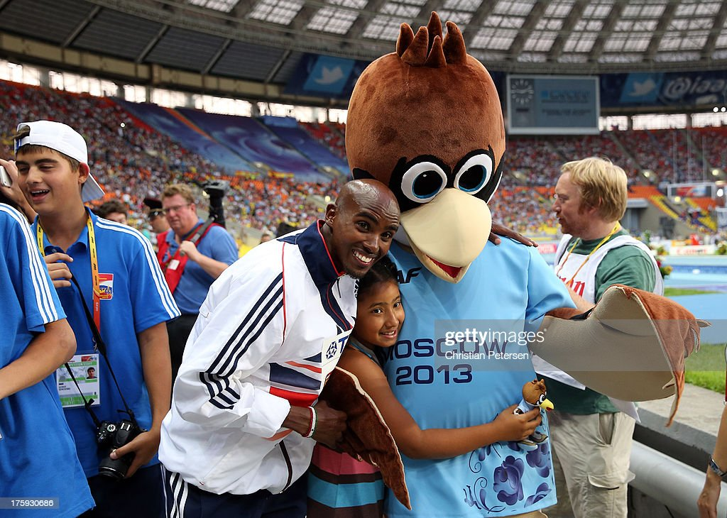 Gold medalist Mo Farah of Great Britain poses with with daughter Rhianna Farah and the games mascot during the medal ceremony for the Men's 10000 metresduring Day One of the 14th IAAF World Athletics Championships Moscow 2013 at Luzhniki Stadium on August 10, 2013 in Moscow, Russia.
