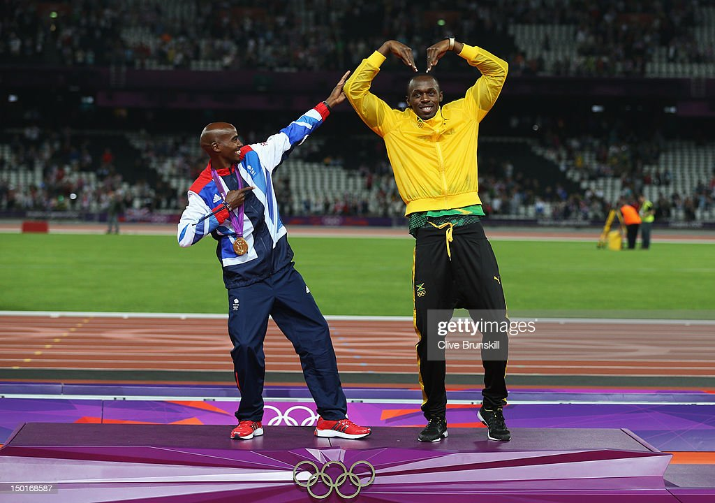 Gold medalist Mohamed Farah of Great Britain (L) and <a gi-track='captionPersonalityLinkClicked' href=/galleries/search?phrase=Usain+Bolt&family=editorial&specificpeople=604196 ng-click='$event.stopPropagation()'>Usain Bolt</a> of Jamaica pose on the podium on Day 15 of the London 2012 Olympic Games at Olympic Stadium on August 11, 2012 in London, England.
