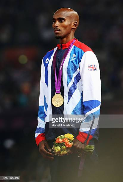 Gold medalist Mohamed Farah of Great Britain celebrates on the podium during the medal ceremony for the Men's 5000m Final on Day 15 of the London...