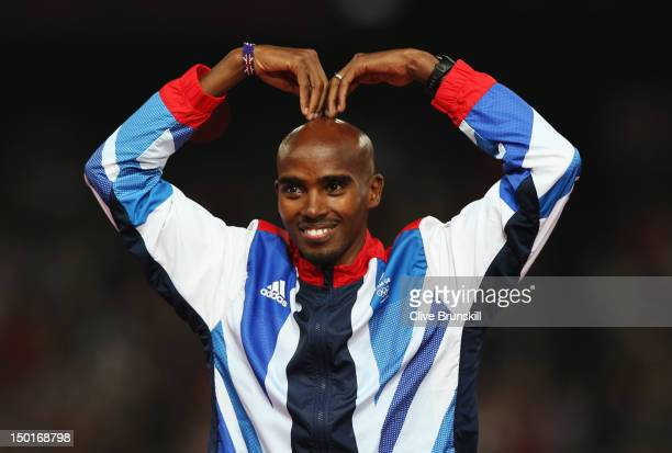 Gold medalist Mohamed Farah of Great Britain celebrates on the podium during the medal ceremony for the Men's 5000m on Day 15 of the London 2012...