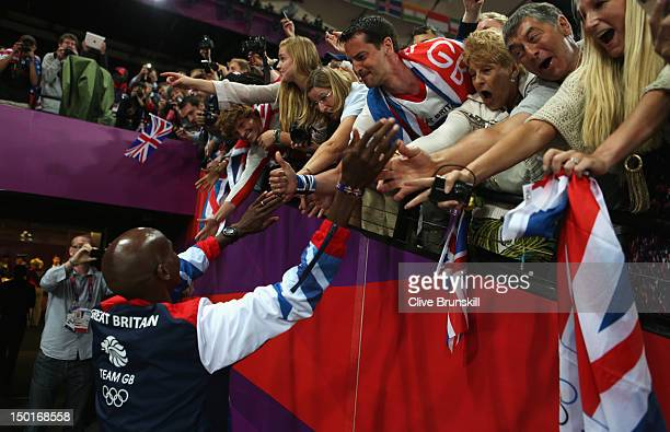Gold medalist Mohamed Farah of Great Britain celebrates with fans during the medal ceremony for the Men's 5000m on Day 15 of the London 2012 Olympic...