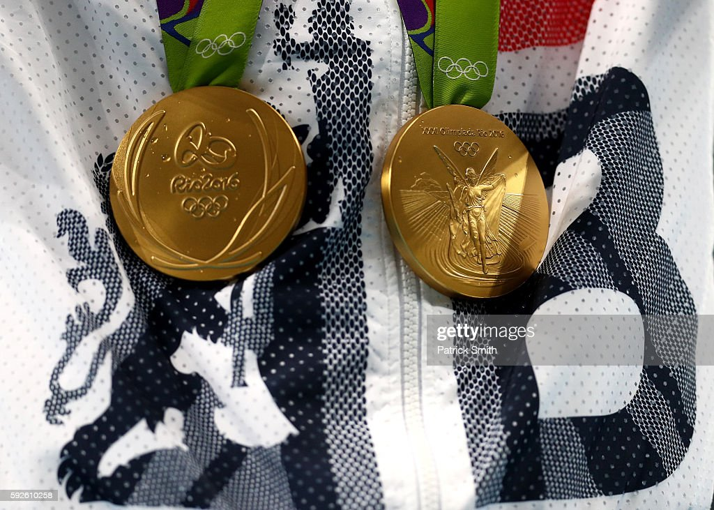 Gold medalist Mohamed Farah of Great Britain holds both his 5000 meter and 10000 meter gold medals on the podium during the medal ceremony for the Men's 5000 meter on Day 15 of the Rio 2016 Olympic Games at the Olympic Stadium on August 20, 2016 in Rio de Janeiro, Brazil.