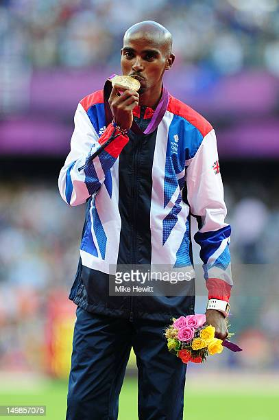 Gold medalist Mohamed Farah of Great Britain poses on the podium for Men's 10000m on Day 9 of the London 2012 Olympic Games at the Olympic Stadium on...