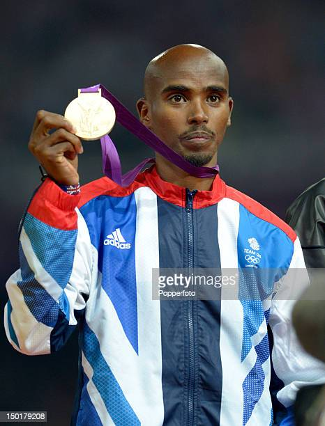 Gold medalist Mohamed Farah of Great Britain poses on the podium during the medal ceremony for the Men's 5000m on Day 15 of the London 2012 Olympic...