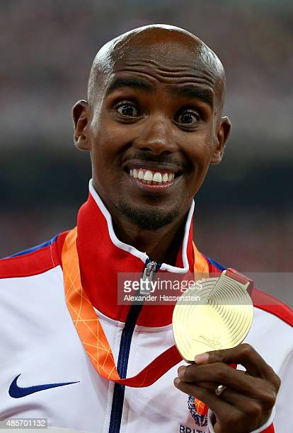Gold medalist Mohamed Farah of Great Britain poses on the podium during the medal ceremony for the Men's 5000 metres final during day eight of the...