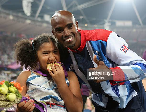 Gold medalist Mohamed Farah of Great Britain poses with his daughter Rihanna Farah after the medal ceremony for the Men's 5000m on Day 15 of the...