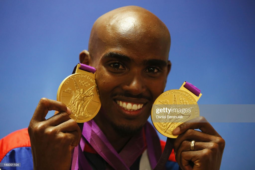 Gold medalist Mohamed Farah of Great Britain poses with his medals for the 10,000m and 5000m as he attends a TEAM GB Press Conference during Day 16 of the London 2012 Olympic Games at Team GB house on August 12, 2012 in London, England.