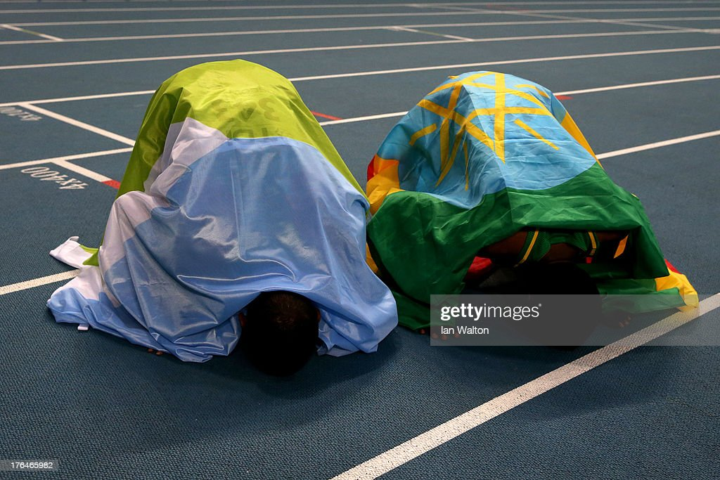 Gold medalist <a gi-track='captionPersonalityLinkClicked' href=/galleries/search?phrase=Mohammed+Aman&family=editorial&specificpeople=7149144 ng-click='$event.stopPropagation()'>Mohammed Aman</a> of Ethiopia and bronze medalist Ayanleh Souleiman of Djibouti celebrate after the Men's 800 metres final during Day Four of the 14th IAAF World Athletics Championships Moscow 2013 at Luzhniki Stadium on August 13, 2013 in Moscow, Russia.