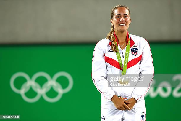 Gold medalist Monica Puig of Puerto Rico poses during the medal ceremony for Women's Singles on Day 8 of the Rio 2016 Olympic Games at the Olympic...
