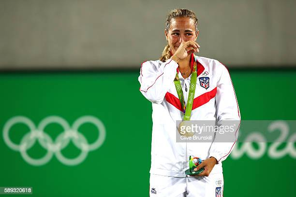 Gold medalist Monica Puig of Puerto Rico reacts during the medal ceremony for Women's Singles on Day 8 of the Rio 2016 Olympic Games at the Olympic...