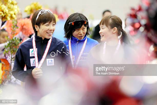Gold medalist Nao Kodaira silver medalist Miho Takagi and bronze medalist Arisa Go celebrate after the medal ceremony for Women's Overall during day...
