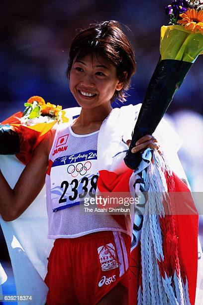Gold medalist Naoko Takahashi of Japan celebrates on the podium at the medal ceremony for the Women's Marathon during the Sydney Olympics at Stadium...