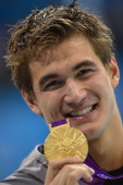 US gold medalist Nathan Adrian poses on the podium after the men's 100m freestyle final swimming event at the London 2012 Olympic Games on August 1...