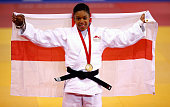 Gold medalist Nekoda Davis of England celebrates on the podium during the medal ceremony for the Womens 57kg l contest at SECC Precinct during day...