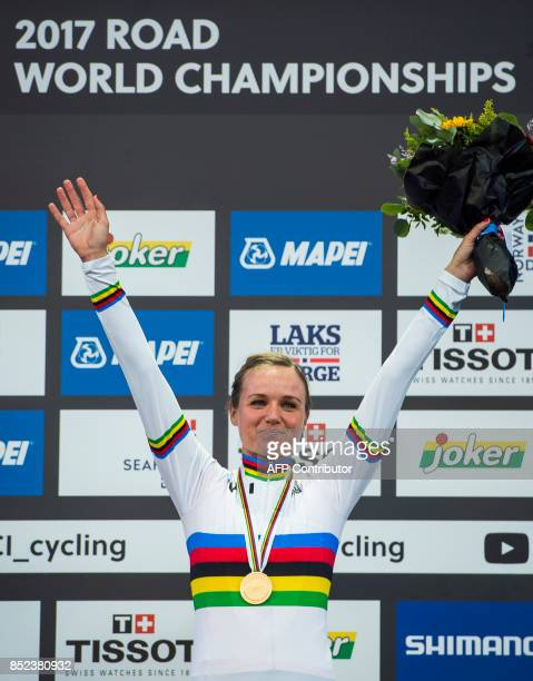 Gold medalist Netherlands' Chantal Blaak celebrates with her medal after winning the women elite road race of the UCI Cycling Road World...