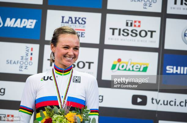 Gold medalist Netherlands' Chantal Blaak reacts with her medal after winning the women elite road race of the UCI Cycling Road World Championships in...