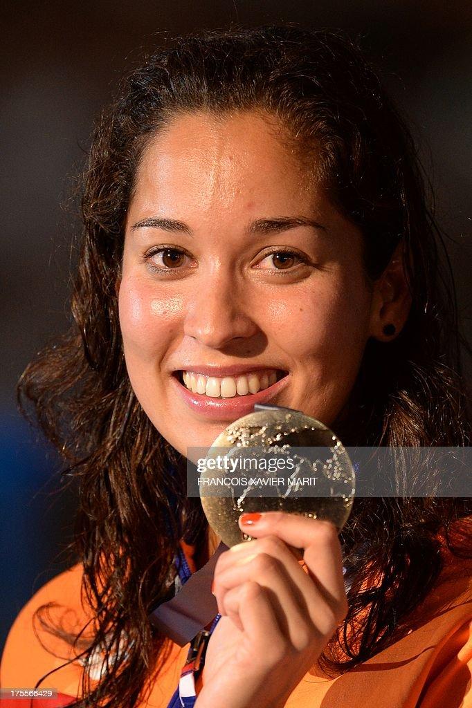 Ranomi Kromowidjojo of the Netherlands celebrates winning the Swimming ...