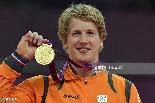 Gold medalist Netherlands's gymnast Epke Zonderland poses on the podium of the men's horizontal bar final of the artistic gymnastics event of the...