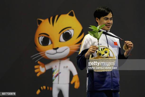 Gold medalist Nguyen Tien Nhat of Vietnam smiles after winning the final Mens's Epee Individual game during victory ceremony as part of the 2017 SEA...