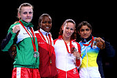 Gold medalist Nicola Adams of England poses with silver medalist Michaela Walsh of Northern Ireland and bronze medalists Mandy Bujold of Canada and...