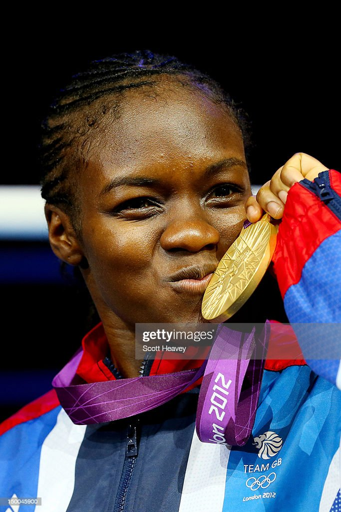 Gold medalist Nicola Adams of Great Britain celebrates on the podium during the medal ceremony after the Women's Fly (51kg) Boxing final bout on Day 13 of the London 2012 Olympic Games at ExCeL on August 9, 2012 in London, England.