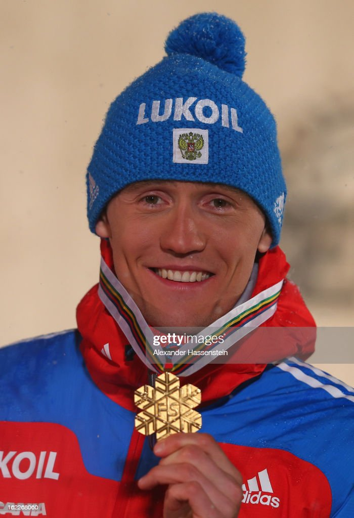 Gold medalist <a gi-track='captionPersonalityLinkClicked' href=/galleries/search?phrase=Nikita+Kriukov&family=editorial&specificpeople=4907513 ng-click='$event.stopPropagation()'>Nikita Kriukov</a> of Russia poses at the medal ceremony for the Men's Cross Country 1.5km Classic Sprint Final at the FIS Nordic World Ski Championships on February 21, 2013 in Val di Fiemme, Italy.
