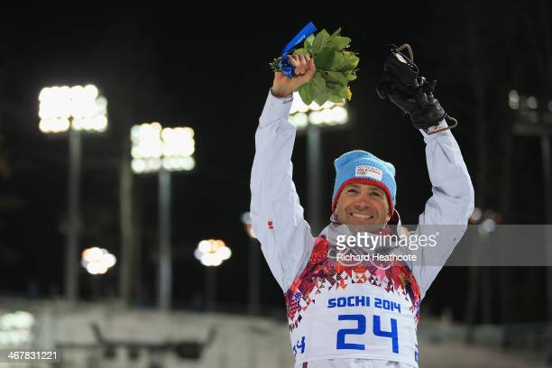 Gold medalist Ole Einar Bjoerndalen of Norway celebrates during the flower ceremony for the Men's Sprint 10 km during day one of the Sochi 2014...
