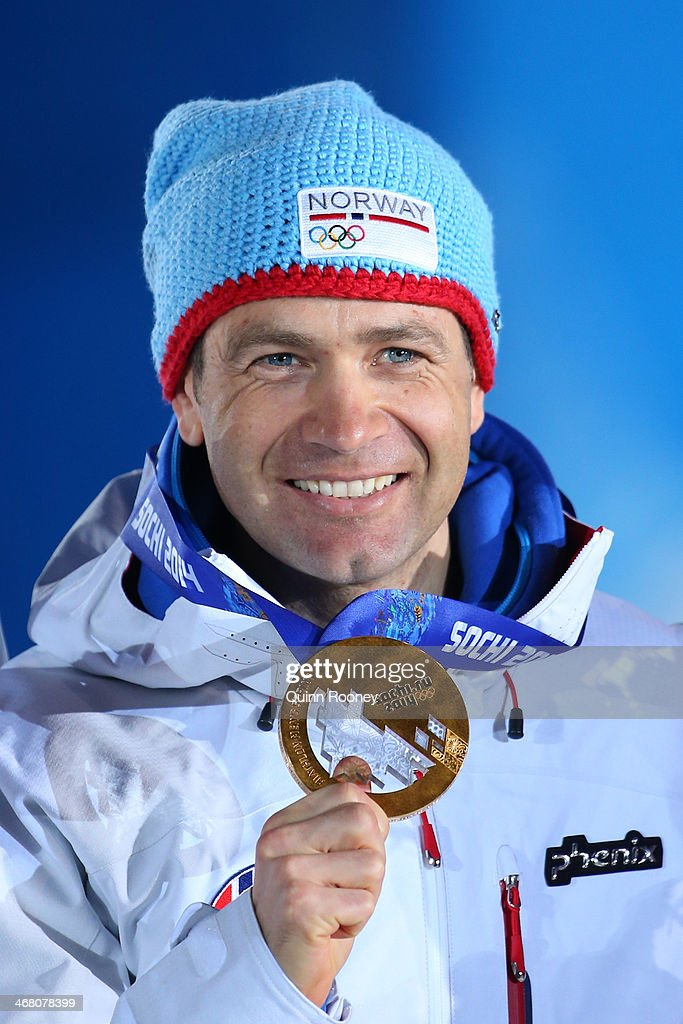 Gold medalist <a gi-track='captionPersonalityLinkClicked' href=/galleries/search?phrase=Ole+Einar+Bjoerndalen&family=editorial&specificpeople=206663 ng-click='$event.stopPropagation()'>Ole Einar Bjoerndalen</a> of Norway celebrates during the medal ceremony for the Men's Sprint 10 km on day 2 of the Sochi 2014 Winter Olympics at Medals Plaza on February 9, 2014 in Sochi, .
