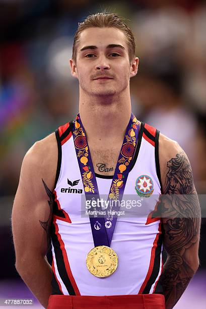 Gold medalist Oleg Stepko of Azebaijan poses with the medal won during the Men's Gymnastics Parallel Bars final on day eight of the Baku 2015...