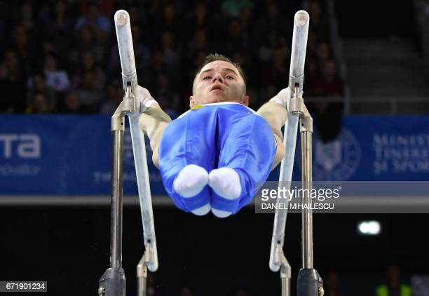 Gold medalist Oleg Verniaev of Ukraine performs on parallel bars of apparatus final for the European Artistic Gymnastics Championship in Cluj Napoca...