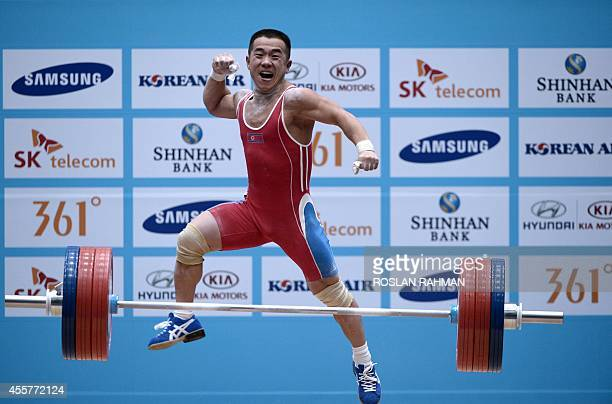 Gold medalist Om YunChol of North Korea celebrates after breaking the world record in the men's 56kg weightlifting event during the 2014 Asian Games...