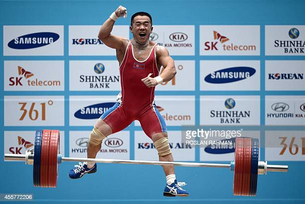 Gold medalist Om YunChol of North Korea celebrates after winning the men's 56kg weightlifting event during the 2014 Asian Games in Incheon on...
