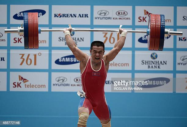 Gold medalist Om YunChol of North Korea lifts during the men's 56kg weightlifting event at the 2014 Asian Games in Incheon on September 20 2014 AFP...