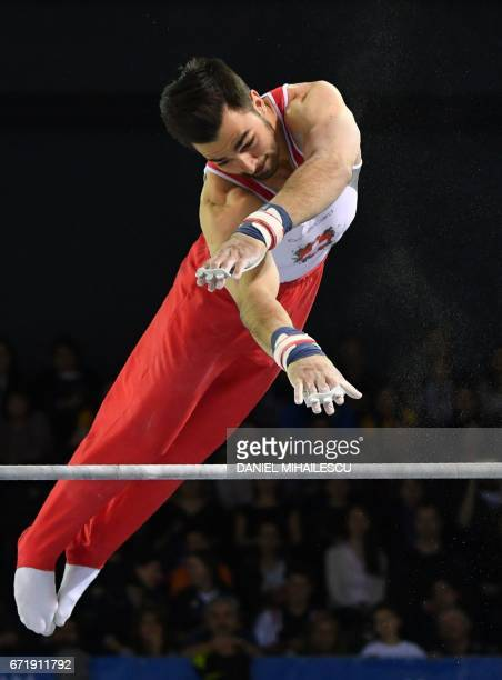 Gold medalist Pablo Braegger of Switzerland performs on the men horizontal bar apparatus final for the European Artistic Gymnastics Championship in...