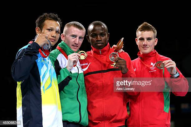 Gold medalist Paddy Barnes of Northern Ireland poses with silver medalist Devendro Laishram of India and bronze medalists Fazil Juma Kaggwa of Uganda...