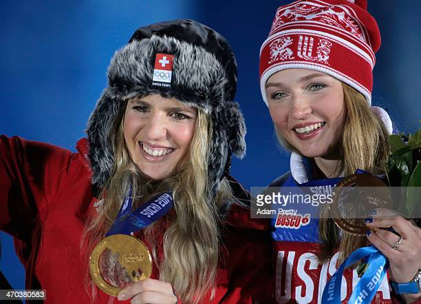 Gold medalist Patrizia Kummer of Switzerland and bronze medalist Alena Zavarzina of Russia celebrate on the podium during the medal ceremony for the...