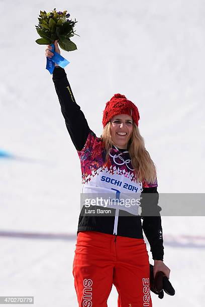 Gold medalist Patrizia Kummer of Switzerland celebrates during the flower ceremony for the Snowboard Ladies' Parallel Giant Slalom Finals on day...