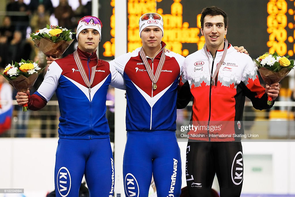 Gold medalist Pavel Kulizhnikov, silver medalist Ruslan Murashov both Russia and bronze medalist Alex Boisvert-Lacroix of Canada attend a victory ceremony for the men's 500 meter race during day 4 of the ISU World Single Distances Speed Skating Championships held at Speed Skating Centre Kolomna Ice Arena on February 14, 2016 in Kolomna, Russia.