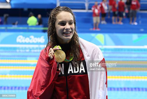 Gold medalist Penny Oleksiak of Canada poses during the medal ceremony for the Women's 100m Freestyle Final on day 6 of the Rio 2016 Olympic Games at...