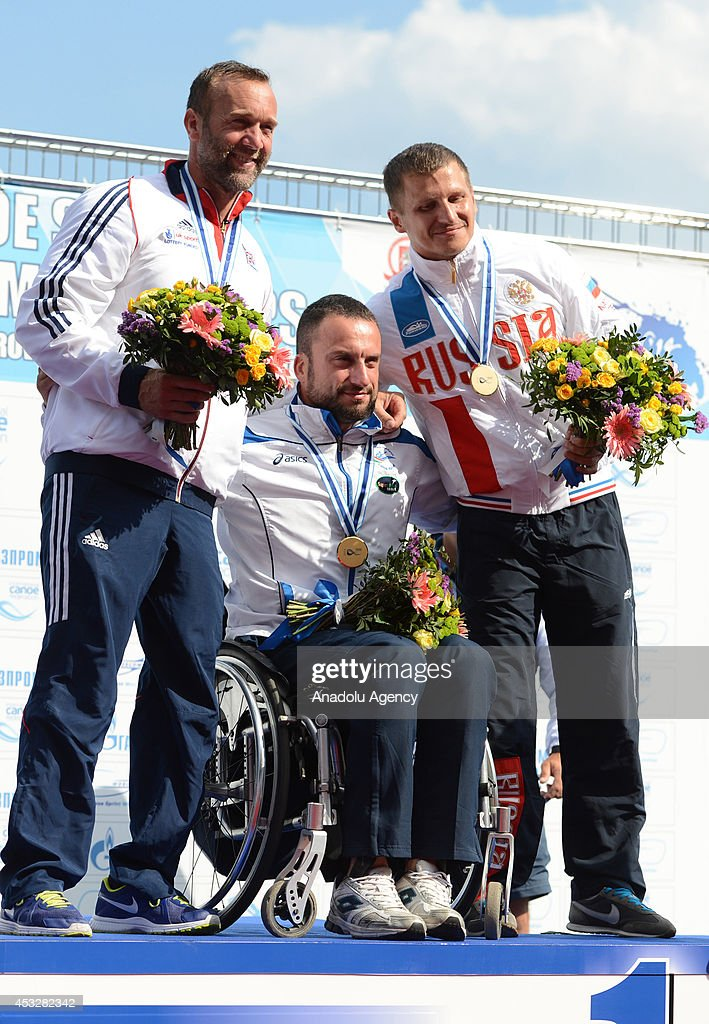 Gold medalist Pier Alberto Buccoliero (C) of Italy, silver medalist Martin Tweedie (L) of Great Britain and bronze medalist Aleksei Egorov (R) of Russia pose with their medals after the men's V1 (LTA) 200m final of the 2014 ICF Canoe Sprint World hampionships in Moscow, Russia on August 6, 2014.