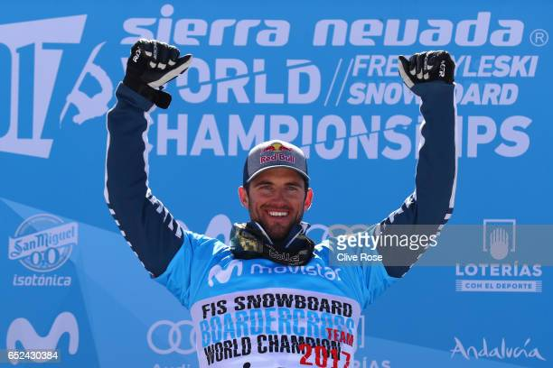 Gold medalist Pierre Vaultier of France poses during the flower ceremony for the Men's Snowboard Cross on day five of the FIS Freestyle Ski Snowboard...